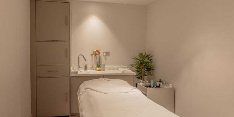 Stratton House: Image of one of the spa treatment rooms, featuring cupboards and storage solutions designed and installed by Crown Sports Lockers.