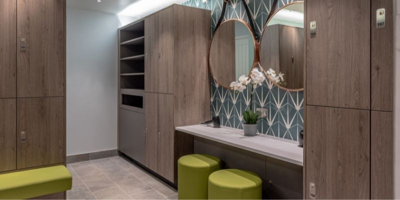 Stratton House: Image of a bespoke wooden 'dry vanity', surrounded by wooden changing room lockers designed and installed by Crown Sports Lockers.